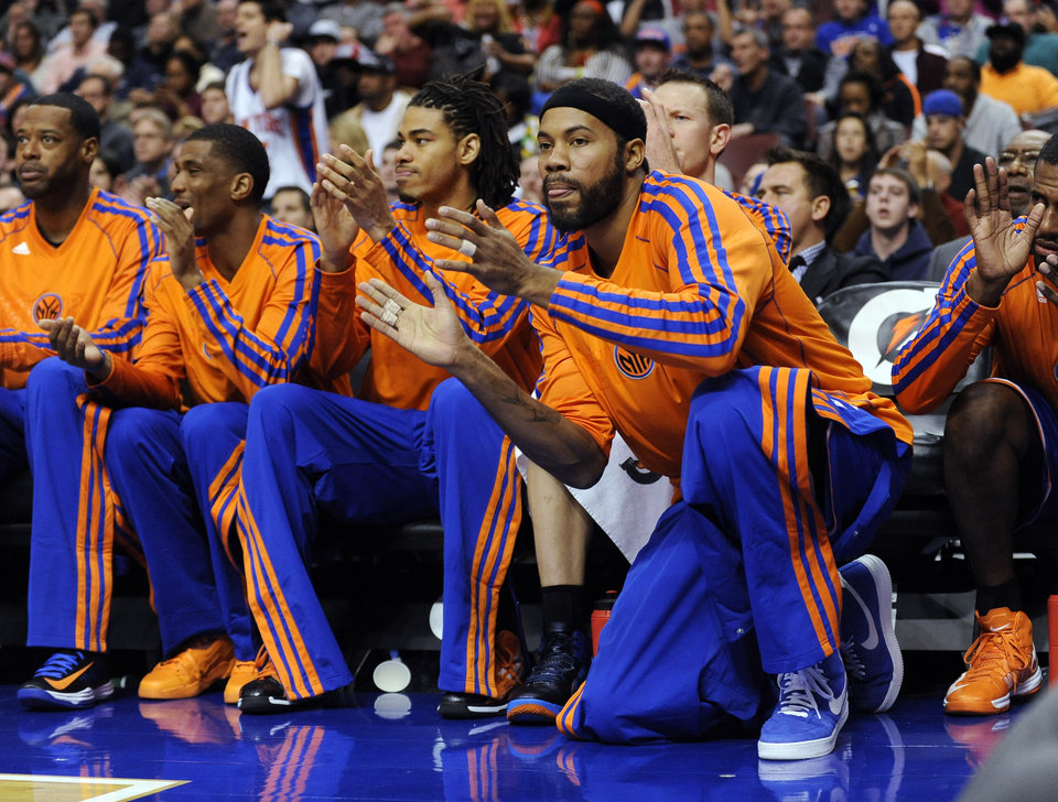 New York Knicks' Rasheed Wallace (36) celebrates while kneeling in front of the bench during the first half of an NBA basketball game against the Philadelphia 76ers on Monday, Nov. 5, 2012, in Philadelphia. (AP Photo/Michael Perez)