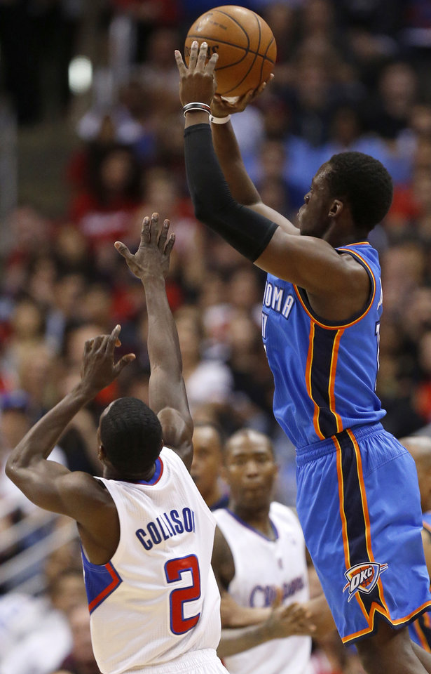 Photo - Oklahoma City's Reggie Jackson (15) shoots over Los Angeles' Darren Collison (2) during Game 4 of the Western Conference semifinals in the NBA playoffs between the Oklahoma City Thunder and the Los Angeles Clippers at the Staples Center in Los Angeles, Sunday, May 11, 2014. Photo by Nate Billings, The Oklahoman