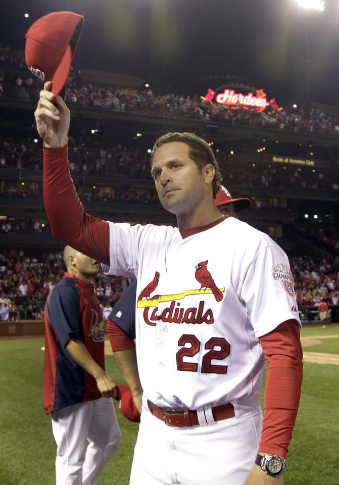 St. Louis Cardinals manager Mike Matheny tips his cap to the crowd after the Cardinals' 1-0 victory over the Cincinnati Reds in a baseball game, Wednesday, Oct. 3, 2012, in St. Louis. (AP Photo/Jeff Roberson)