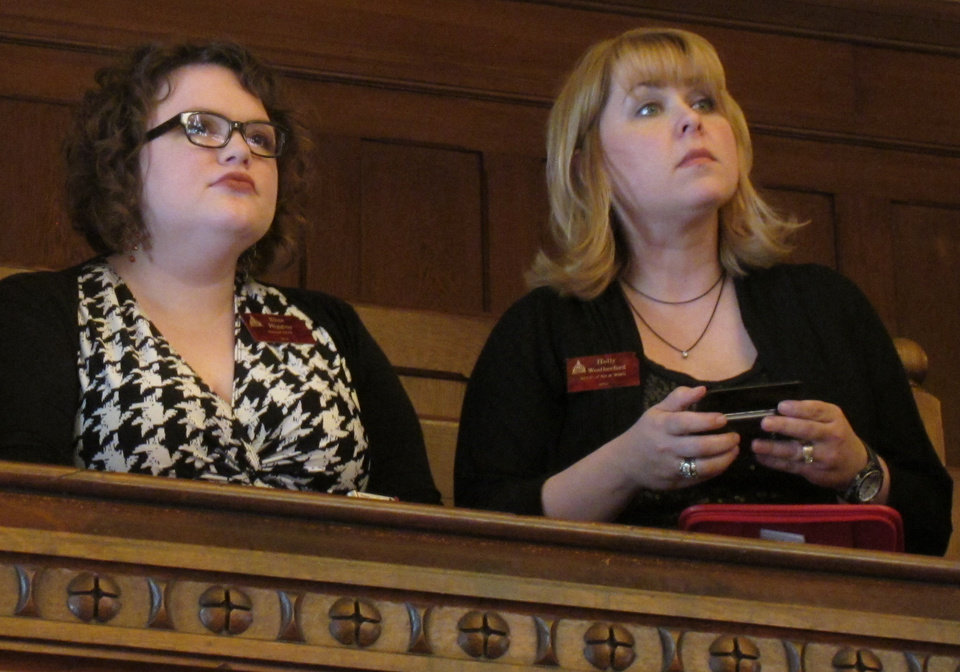 Photo - Kansas abortion-rights lobbyists Elise Higgins, left, and Holly Weatherford, watch the Senate's debate on anti-abortion legislation from the gallery, Friday, April 5, 2013, at the Statehouse in Topeka, Kan. Higgins represents the Kansas chapter of the National Organization for Women and Weatherford, the American Civil Liberties Union of Kansas and Western Missouri. (AP Photo/John Hanna)
