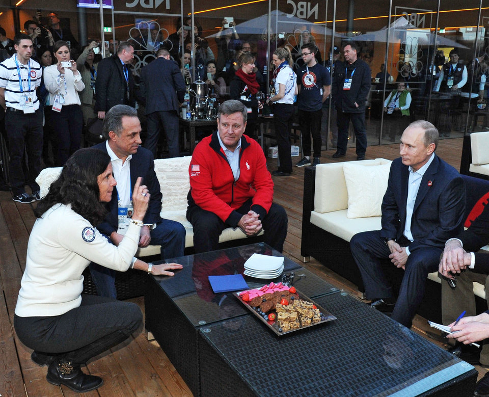 Photo - Russian President Vladimir Putin, right, visits USA House during the 2014 Winter Olympics, Friday, Feb. 14, 2014 in Sochi, Russia. From left, US Olympic Committee official Lisa Baird, Russian Sports Minister Vitaly Mutko and Head of the United States National Olympic Committee Scott Blackman.  (AP Photo/RIA-Novosti, Mikhail Klimentyev, Presidential Press Service)