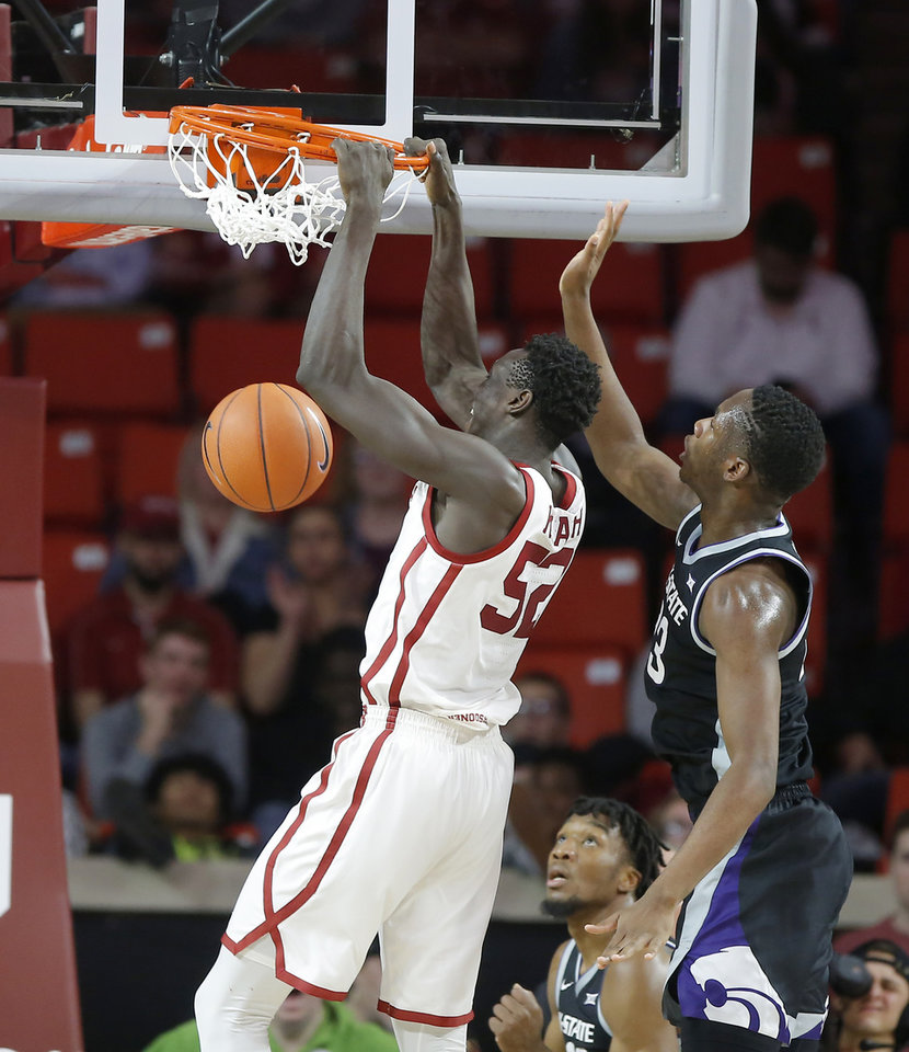Photo - Oklahoma's Kur Kuath (52) dunks the ball beside Kansas State's Montavious Murphy (23) during an NCAA college basketball game between the University of Oklahoma Sooners (OU) and the Kansas State Wildcats at Lloyd Noble Center in Norman, Okla., Saturday, Jan. 4, 2020. Oklahoma won 66-61. [Bryan Terry/The Oklahoman]