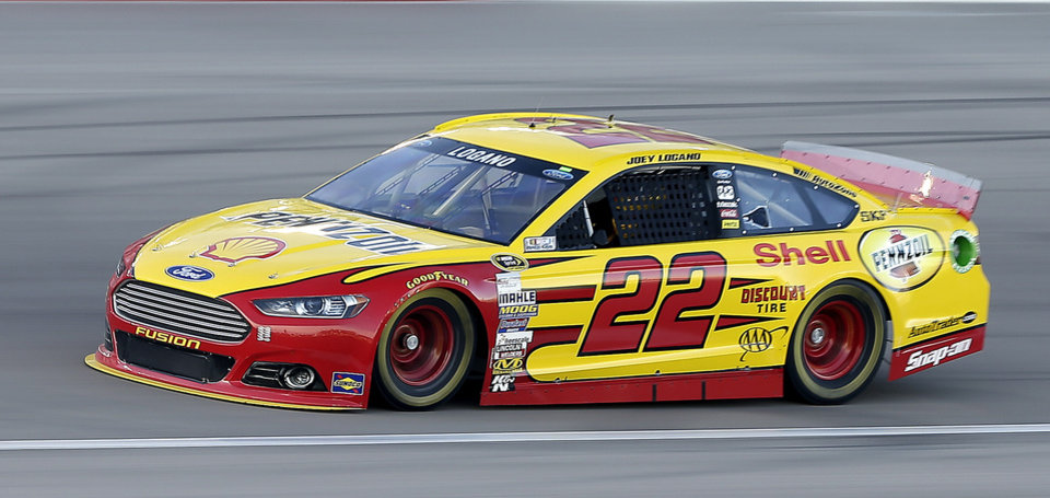 Photo - Joey Logano drives during qualifying for a NASCAR Sprint Cup Series auto race on Friday, March 7, 2014, in Las Vegas. Logano won the pole. (AP Photo/Isaac Brekken)