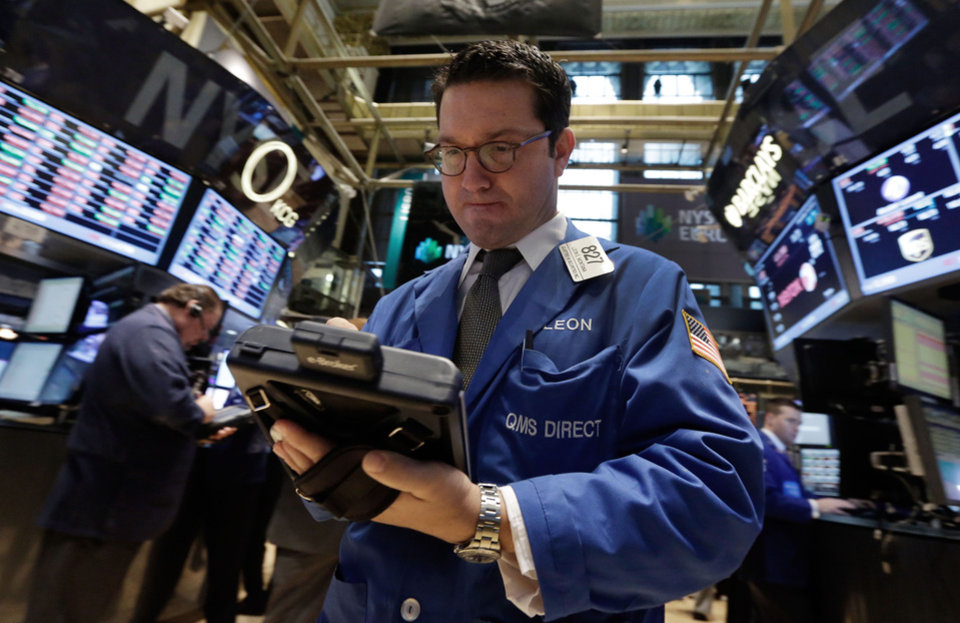 Photo - Trader Leon Montana works on the floor of the New York Stock Exchange, Thursday, Dec. 19, 2013. Stocks edged lower in early trading Thursday, pulling back from record levels. (AP Photo/Richard Drew)