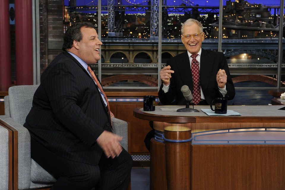 In this photo released by CBS Broadcasting, New Jersey Gov. Chris Christie, left, and late night host David Letterman, right, react with laughter during the Governor's first visit to CBS� �Late Show with David Letterman,� on Monday, Feb. 4, 2013 in New York. (AP Photo/CBS Broadcasting, Jeffrey Neira)