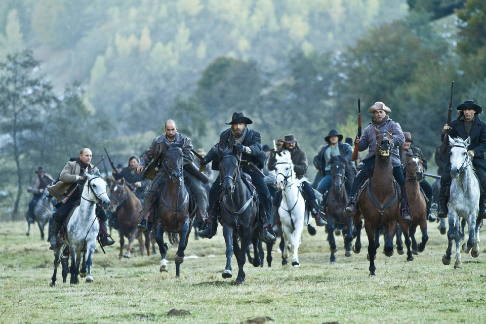 Photo - Devil Anse Hatfield (Kevin Costner) leads the charge in