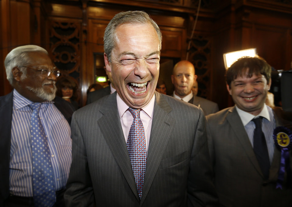 Photo - Nigel Farage leader of Britain's UK Independence Party (UKIP) laughs as he arrives to hear results of the south east region European Parliamentary Election vote at the Guildhall in Southampton, England, Sunday, May 25, 2014. From Portugal to Finland, voters of 21 nations cast ballots Sunday to decide the makeup of the next European Parliament and help determine the European Union's future leaders and course. (AP Photo/Kirsty Wigglesworth)