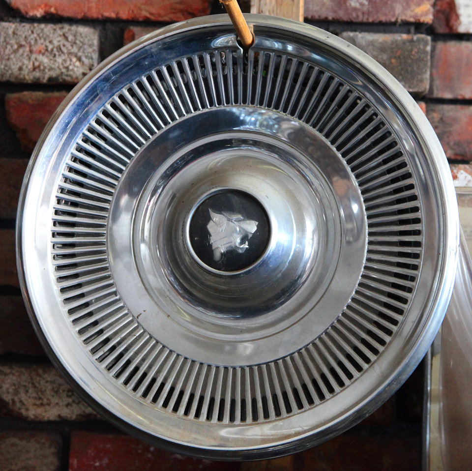 71' Buick Wildcat hubcap at Sandra Mullins' Hubcap World in Oklahoma City, Wednesday,  Feb. 13, 2013.   Her father started the business more than 45 years ago. Photo By David McDaniel, The Oklahoman <strong>David McDaniel - The Oklahoman</strong>