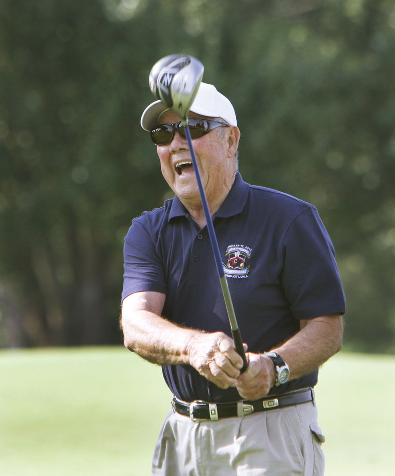 Photo - Bill Thorpe, son of Jim Thorpe, tees off during a golf tournament that was part of the Jim Thorpe Native American Games at Lincoin Park Golf Course in June.  PHOTO BY DAVID MCDANIEL, THE OKLAHOMAN   David McDaniel - The Oklahoman
