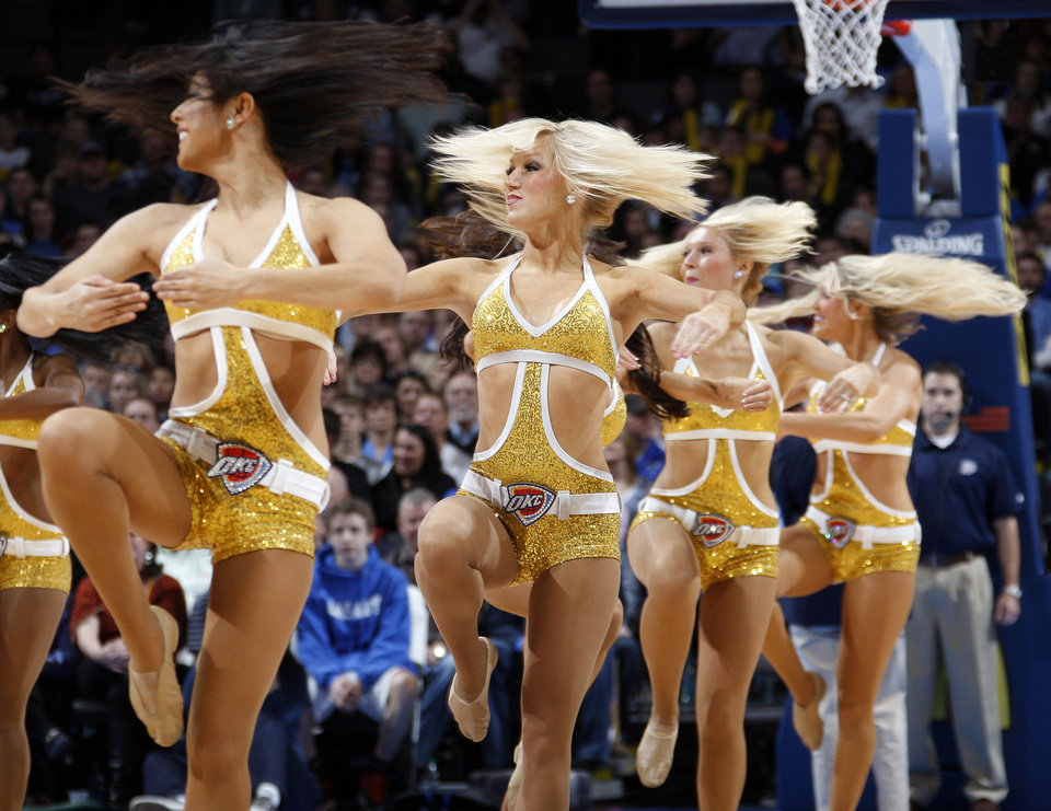 Photo - The Thunder Girls dance team performs during the NBA basketball game between the Oklahoma City Thunder and Phoenix Suns at Chesapeake Energy Arena in Oklahoma City, Saturday, Dec. 31, 2011. Photo by Nate Billings, The Oklahoman