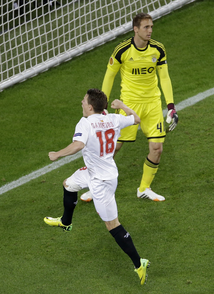 Photo - Sevilla's Kevin Gameiro  celebrates after scoring the winning penalty during the Europa League soccer final between Sevilla and Benfica, at the Turin Juventus stadium in Turin, Italy, Wednesday, May 14, 2014. Sevilla beat Benfica 4-2 on penalties to win Europa League final. (AP Photo/Luca Bruno)