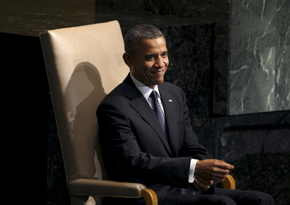 Photo -   President Barack Obama smiles before addressing the 67th session of the General Assembly at United Nations headquarters, Tuesday, Sept. 25, 2012. (AP Photo/Seth Wenig)