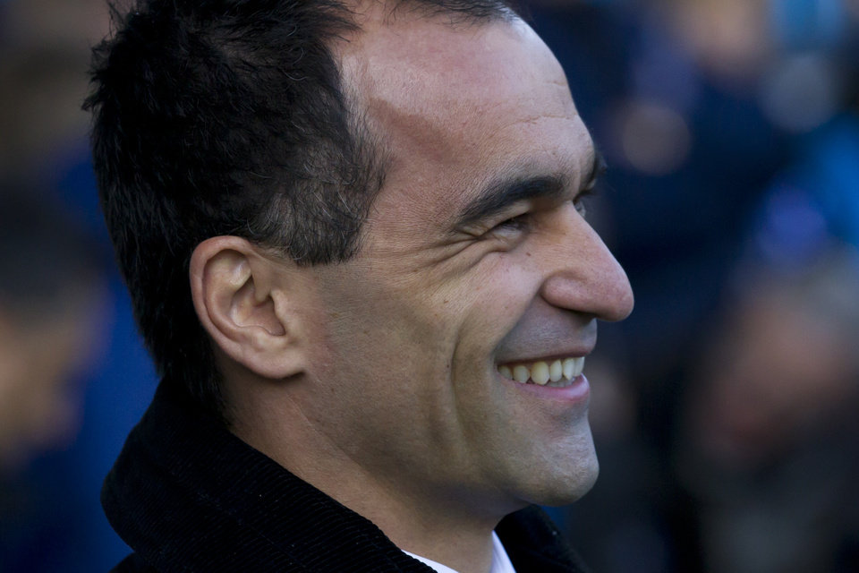 Photo - Everton's manager Roberto Martinez smiles as he takes to the touchline before his team's English Premier League soccer match against West Ham United at Goodison Park Stadium, Liverpool, England, Saturday March 1, 2014. (AP Photo/Jon Super)
