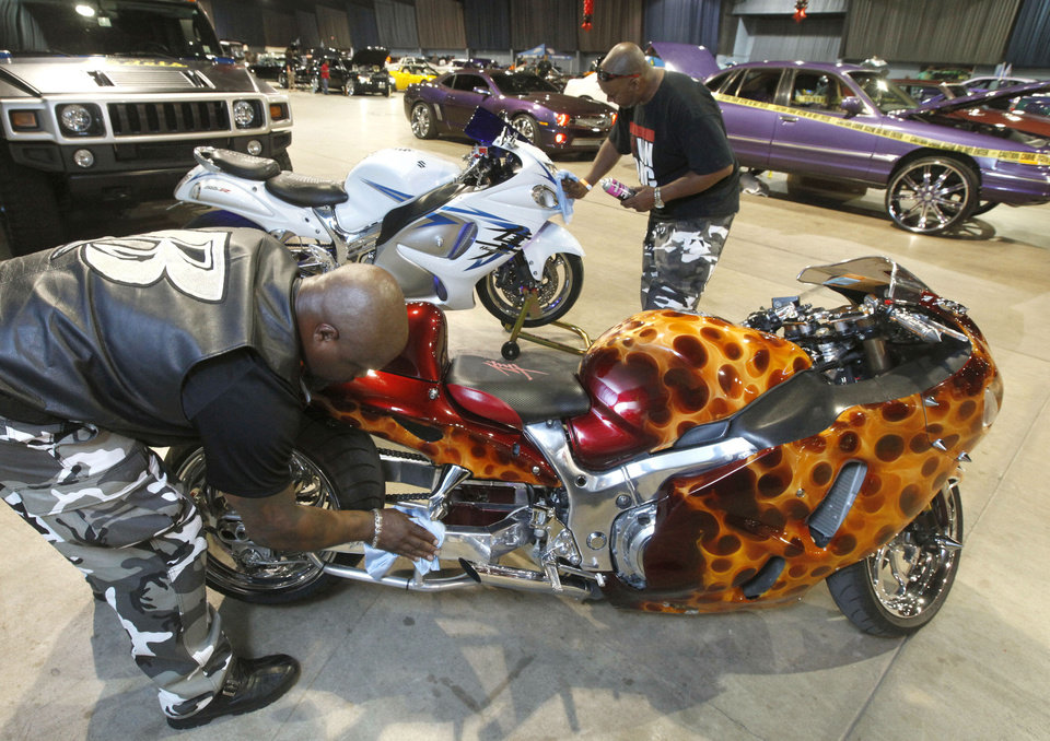 Photo - Richard Bradshaw, left, and Willie Lloyd III polish their bikes during the Car and Bike Show at State Fair Park in Oklahoma City, OK, Saturday, August 17, 2013,  Photo by Paul Hellstern, The Oklahoman