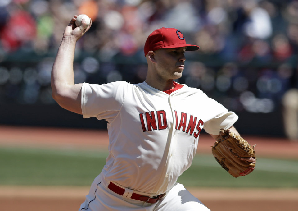 Photo - Cleveland Indians starting pitcher Justin Masterson throws in the first inning of a baseball game against the Minnesota Twins, Sunday, April 6, 2014, in Cleveland. (AP Photo/Tony Dejak)