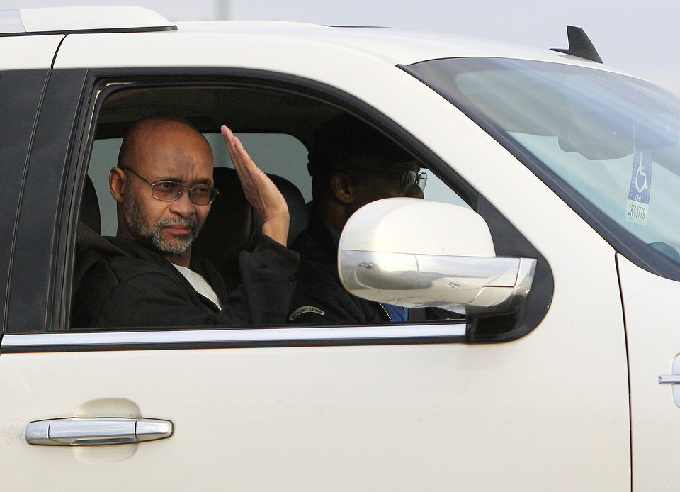 Doug Prade, a former Ohio police captain who has spent nearly 15 years in prison for his ex-wife's killing, waves as he is driven from the Madison Correctional Institution after being released Tuesday, Jan. 29, 2013, in London, Ohio. Prade was exonerated by DNA testing. (AP Photo/Jay LaPrete)