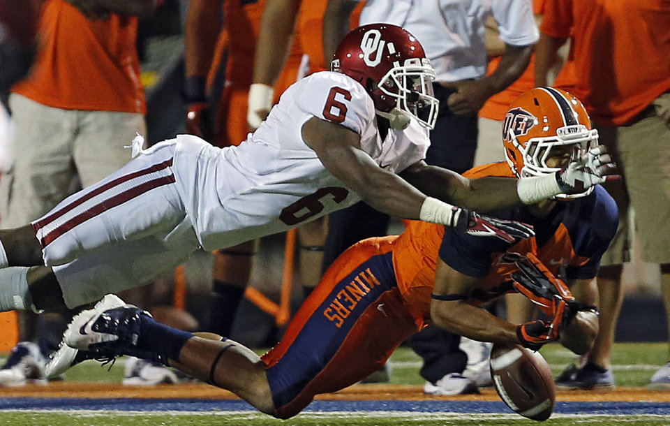 Oklahoma Sooners defensive back Demontre Hurst (6) breaks up a pass for UTEP\'s Jordan Leslie (9) during the college football game between the University of Oklahoma Sooners (OU) and the University of Texas El Paso Miners (UTEP) at Sun Bowl Stadium on Saturday, Sept. 1, 2012, in El Paso, Tex. Photo by Chris Landsberger, The Oklahoman
