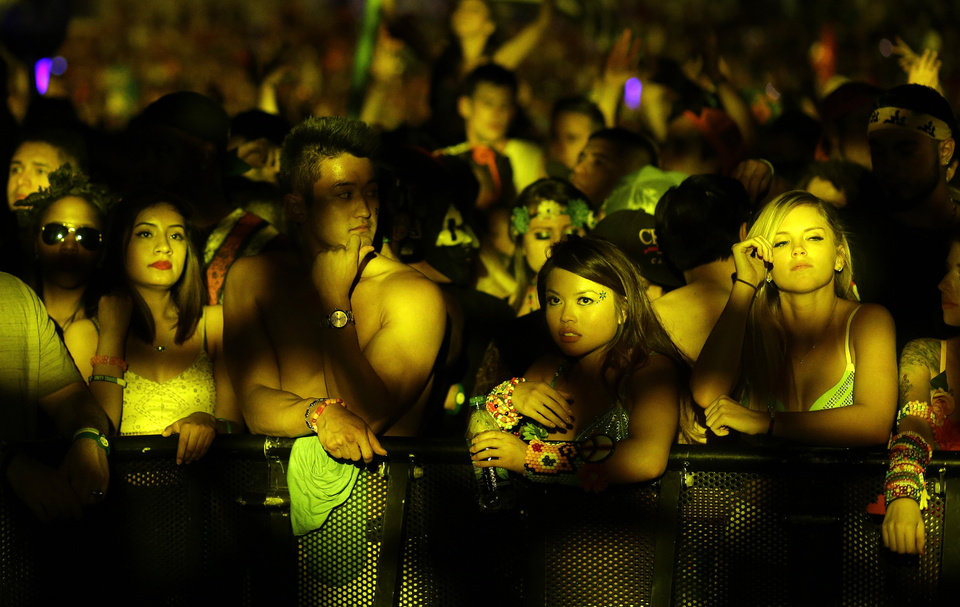 Photo - Festival goers relax during a lull in the music at the Electric Daisy Carnival, Saturday, June 21, 2014, in Las Vegas. (AP Photo/John Locher)