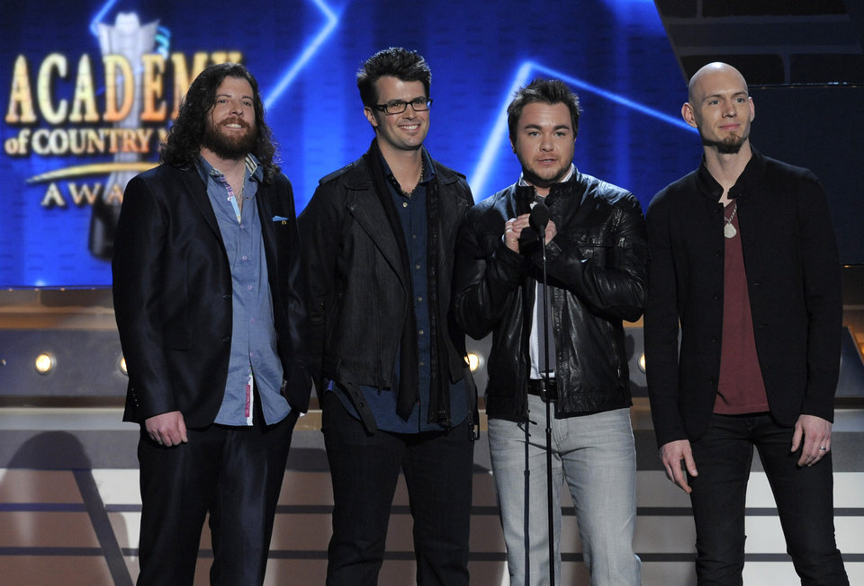 Photo - From left, James Young, Chris Thompson, Mike Eli and Jon Jones, of musical group Eli Young Band, speak on stage at the 48th Annual Academy of Country Music Awards at the MGM Grand Garden Arena in Las Vegas on Sunday, April 7, 2013. (Photo by Chris Pizzello/Invision/AP) ORG XMIT: NVPM227