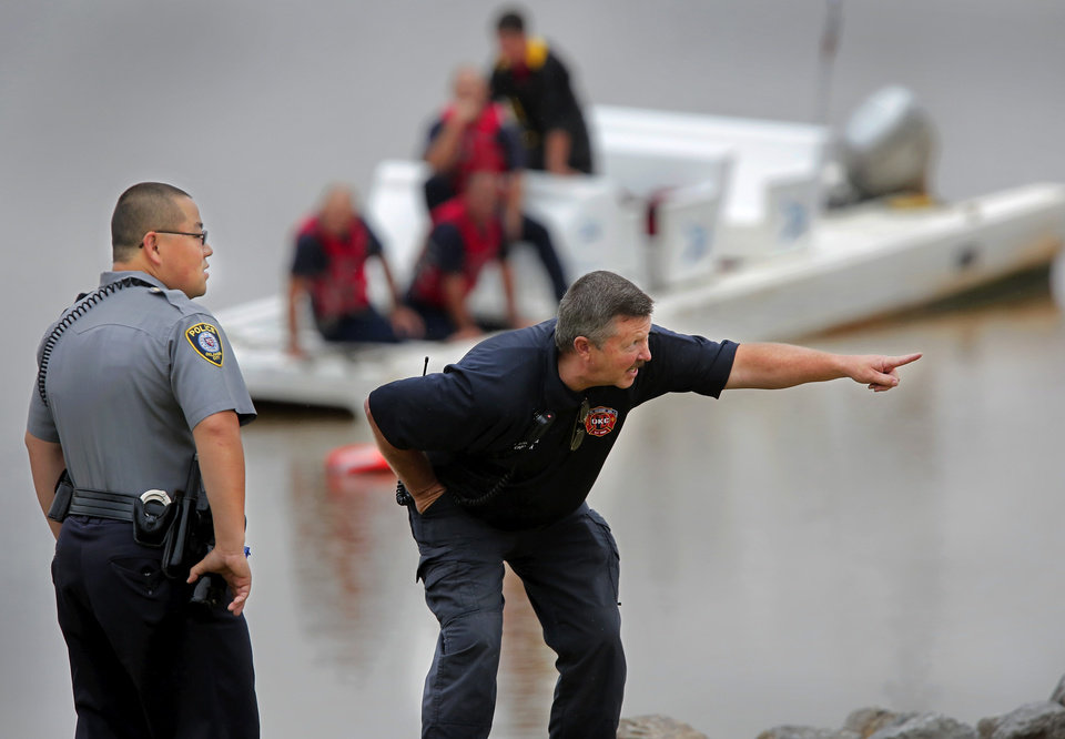 Photo -  Oklahoma City Fire Department divers assisted Thursday afternoon in finding and removing a truck from the Oklahoma River. A person at the Chesapeake Boathouse reported seeing the vehicle roll down a ramp into the water under the Byers Avenue bridge near SE 6. No one was inside the truck when it was recovered. Photo by Jim Beckel, The Oklahoman   Jim Beckel -