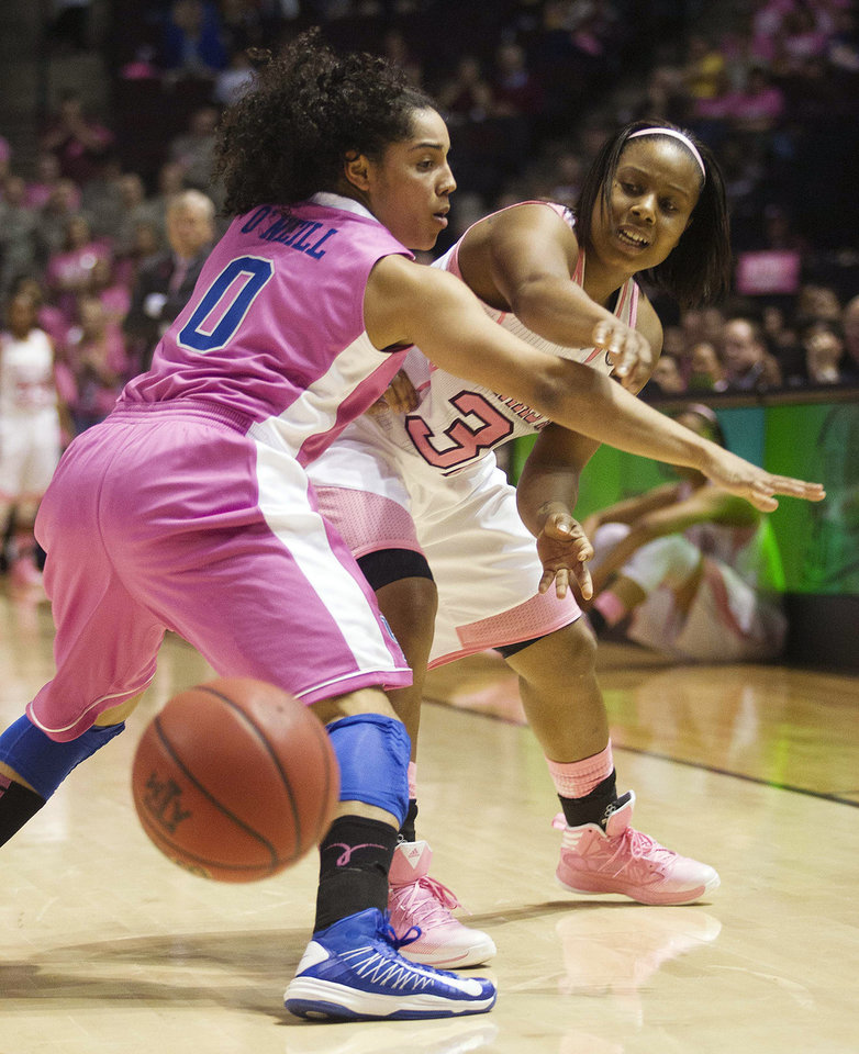 Photo - Texas A&M guard Adrienne Pratcher (32) passes the ball around Kentucky guard Jennifer O'Neill (0) during the first half of an NCAA college basketball game, Monday, Feb. 18, 2013, in College Station, Texas. (AP Photo/Patric Schneider)