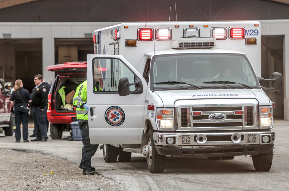 Photo - Fire and rescue crews were called to the Rolls Royce plant in Indianapolis on Friday March 28, 2014 after an explosion involving an acid vat. Eight workers were transported to area hospitals in stable condition. The plant remains evacuated, and second shift has been cancelled. (AP Photo/The Indianapolis Star, Michelle Pemberton)  NO SALES