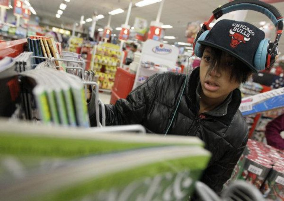 Photo - In this Nov. 24  photo, Jasmine Rogers shops in a Kmart in Chicago. AP FILE PHOTO  Nam Y. Huh