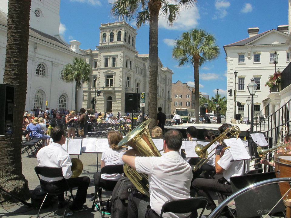 Photo - FILE - In this May 24, 2013 file photo, the Charleston Symphony Orchestra Brass Ensemble performs as the audience gathers for the opening ceremonies of the Spoleto Festival USA in Charleston, S.C. Tourism is an estimated $18 billion industry in South Carolina and a new season is gearing up the week of February 9, 2014, with the Governor's Conference on Tourism and Travel on Hilton Head Island, the Southeastern Wildlife Exposition in Charleston and other events. (AP Photo/Bruce Smith, File)