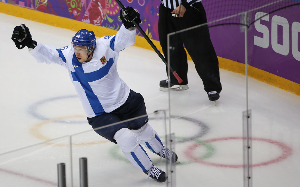 Photo - Jussi Jokinen of Finland celebrates his goal against the United States during the second period of the men's bronze medal ice hockey game at the 2014 Winter Olympics, Saturday, Feb. 22, 2014, in Sochi, Russia. (AP Photo/Julio Cortez)