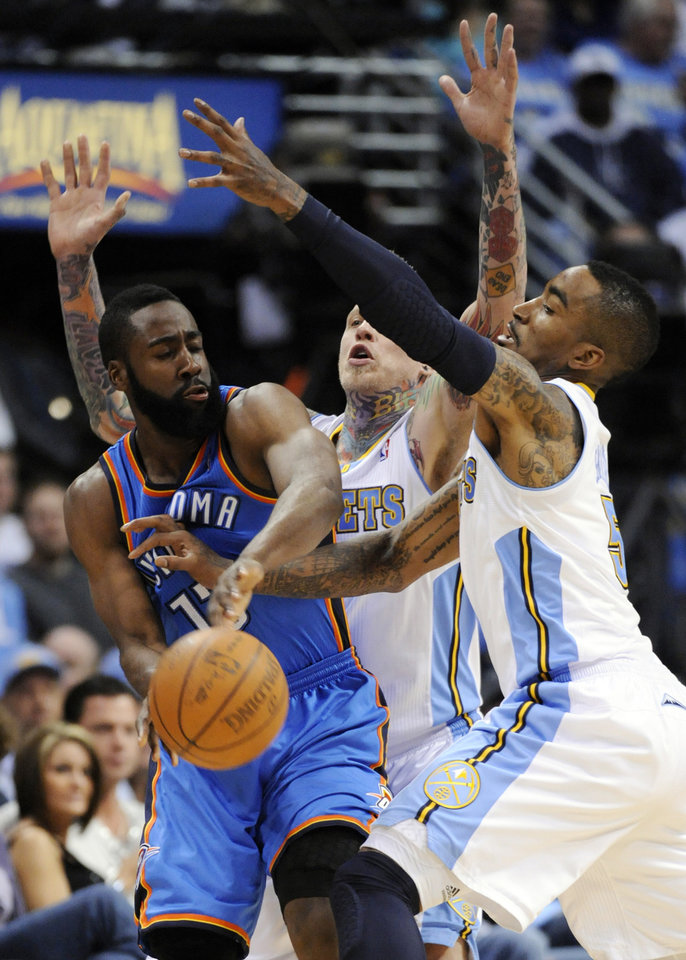 Photo - Oklahoma City Thunder guard James Harden (13) is pressured by Denver Nuggets center Chris Andersen (11) and J.R. Smith, right, during the second half of game 3 of a first-round NBA basketball playoff series Saturday, April 23, 2011, in Denver. (AP Photo/Jack Dempsey)