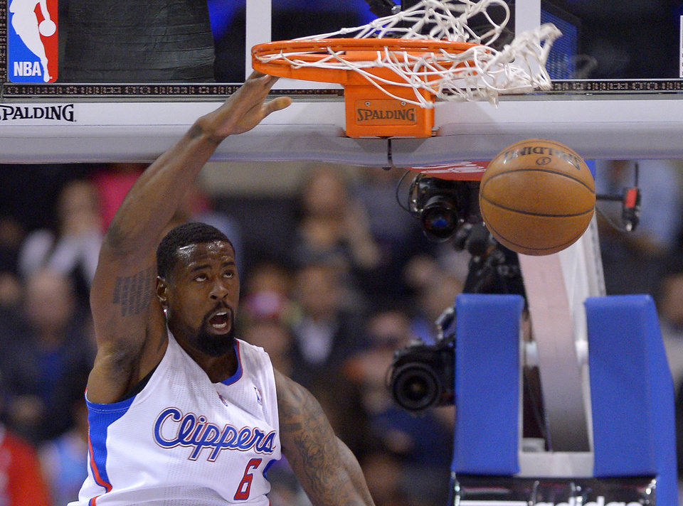 Los Angeles Clippers center DeAndre Jordan dunks during the first half of their NBA basketball game against the Utah Jazz, Wednesday, Oct. 23, 2013, in Los Angeles. (AP Photo/Mark J. Terrill)