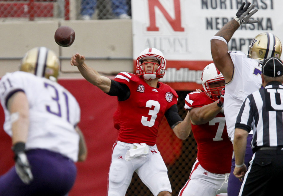 Nebraska\'s Taylor Martinez throws during the first half of an NCAA college football game against Washington, Saturday, Sept. 17, 2011, in Lincoln, Neb. Martinez threw for two touchdowns and ran for a third, and No. 11 Nebraska held off Washington for a wild 51-38 victory. (AP Photo/Nati Harnik) ORG XMIT: NENH118