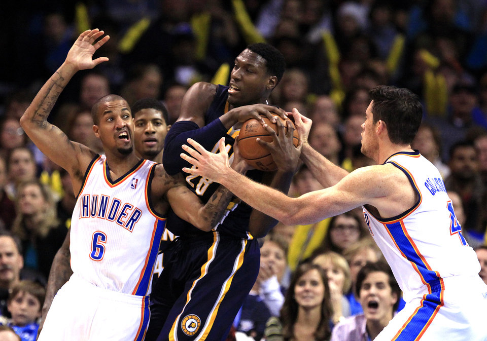 Oklahoma City's Eric Maynor (6) and Nick Collison (4) pressure Indiana's Ian Mahinmi (28) during the NBA game between the Indiana Pacers and the Oklahoma City Thunder at the Chesapeake Energy Arena   Sunday,Dec. 9, 2012. Photo by Sarah Phipps, The Oklahoman