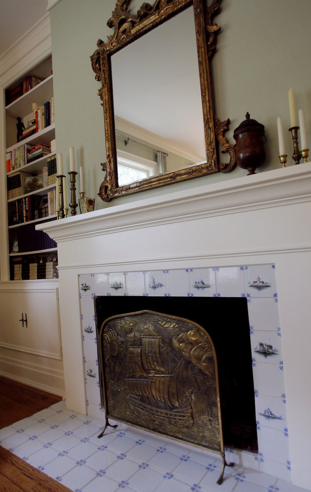 Photo - New fireplace in the living room of the home of the Sergent family, 514 NW 14, for the Centennial Heritage Hills home and garden tour, in Oklahoma City, Friday, Sept. 28, 2007. By MATT STRASEN, The Oklahoman
