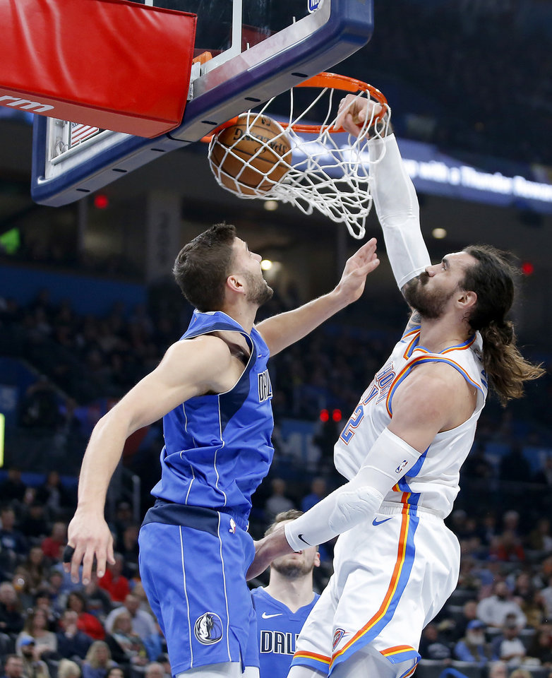 Photo - Oklahoma City's Steven Adams (12) dunks beside Maxi Kleber (42) of Dallas during an NBA basketball game between the Oklahoma City Thunder and the Dallas Mavericks at Chesapeake Energy Arena in Oklahoma City, Tuesday, Dec. 31, 2019. [Bryan Terry/The Oklahoman]