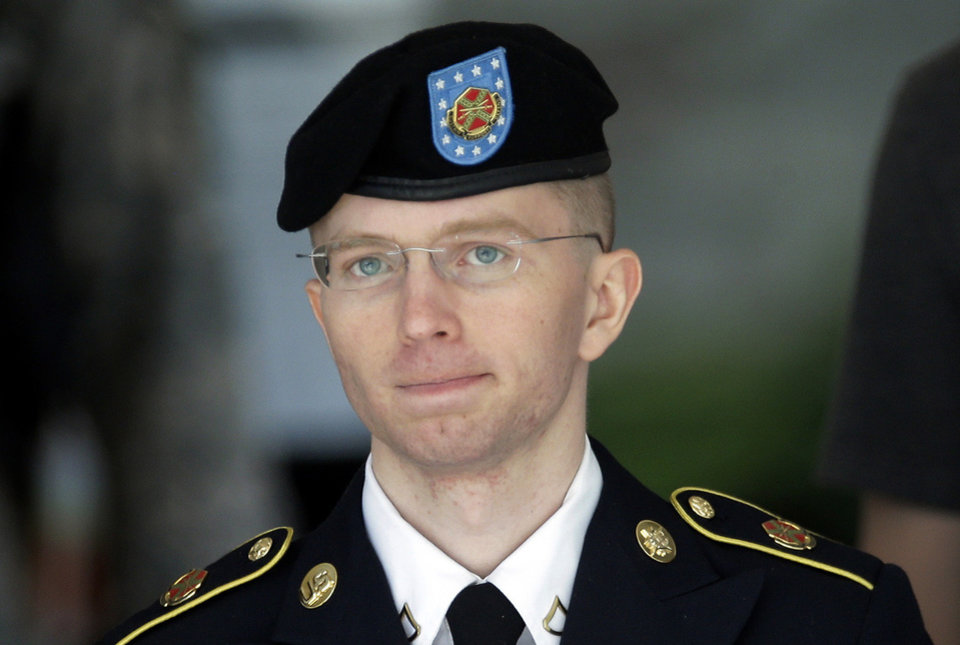 Photo - FILE -  In this  June 5, 2013, file photo Army Pvt. Chelsea Manning, then-Army Pfc. Bradley Manning, is escorted out of a courthouse in Fort Meade, Md., after the third day of his court martial. The U.S. government's aggressive prosecution of leaks and efforts to control information are having a chilling effect on journalists and government whistle-blowers, according to a report released Thursday on U.S. press freedoms under the Obama administration. Manning provided information to the anti-secrecy group Wikileaks. (AP Photo/Patrick Semansky, File)
