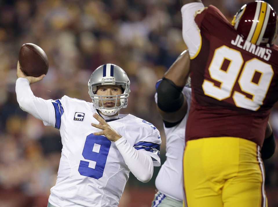 File- This Dec. 30, 2012 file photo shows Dallas Cowboys quarterback Tony Romo (9) throwing a pass during the first half of an NFL football game against the Washington Redskins in Landover, Md.  Romo and the Cowboys have agreed on a six-year contract extension worth $108 million, with about half of that guaranteed.  The agreement was reported on the team's website Friday March 29, 2013. (AP Photo/Evan Vucci, File)