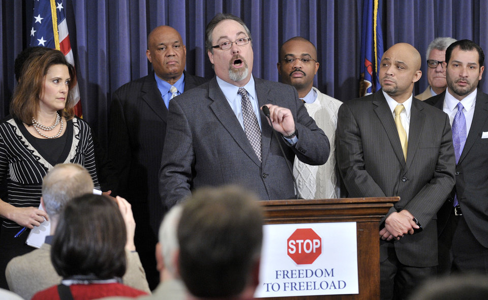 "House Minority leader Richard Hammel, D-Mt Morris, speaks to the crowd Wednesday afternoon, Dec. 5, 2012 at the Capitol in Lansing, Mich., as House and Senate Democrats hold a news conference to speak on the possibility of ""Right To Work"" legislation coming up for a vote. (AP Photo/The Detroit News, Dale G. Young)"