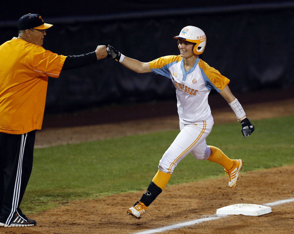 Photo - Tennessee's Megan Geer rounds third headed for a score after a home run against Oklahoma, after a rain delay in Game 2 of the NCAA college softball super regional at Marita Hynes Field on Saturday, May 24, 2014, in Norman, Okla. (AP PhotoThe Oklahoman, Steve Sisney)