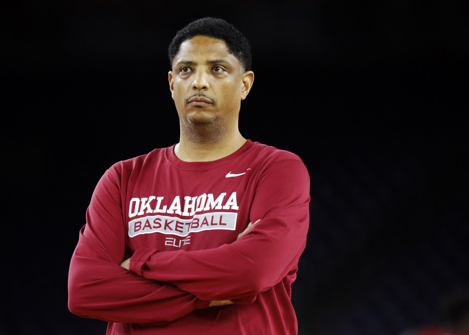 Photo - Oklahoma assistant coach Lew Hill watches practice on Final Four Friday before the national semifinal between the Oklahoma Sooners and the Villanova Wildcats in the NCAA Men's Basketball Championship at NRG Stadium in Houston, Friday, April 1, 2016. OU will play Villanova in the Final Four on Saturday. Photo by Nate Billings, The Oklahoman
