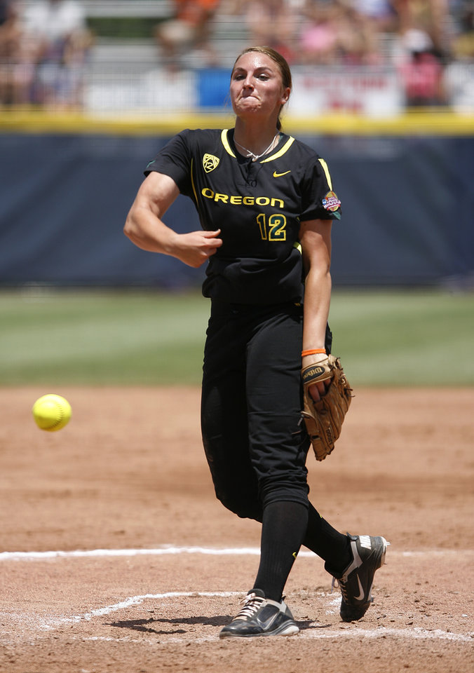 Oregon's Jessica Moore (12) pitches during a Women's College World Series game between Tennessee and Oregon at ASA Hall of Fame Stadium in Oklahoma City, Saturday, June 2, 2012. Photo by Garett Fisbeck, The Oklahoman