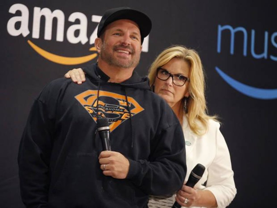 Photo - Garth Brooks and Trisha Yearwood speak to the media Friday during a news conference at the Chesapeake Energy Arena in Oklahoma City. Photo by Sarah Phipps, The Oklahoman