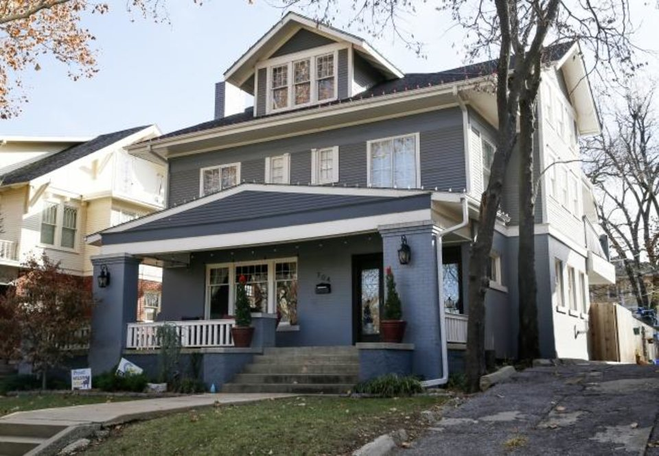 Photo -  Andy and Jennifer Bowman's American Foursquare-style home at 704 NW 18, built in 1912, will provide the refreshment porch for the Mesta Park Holiday Home Tour. [NATE BILLINGS/THE OKLAHOMAN]