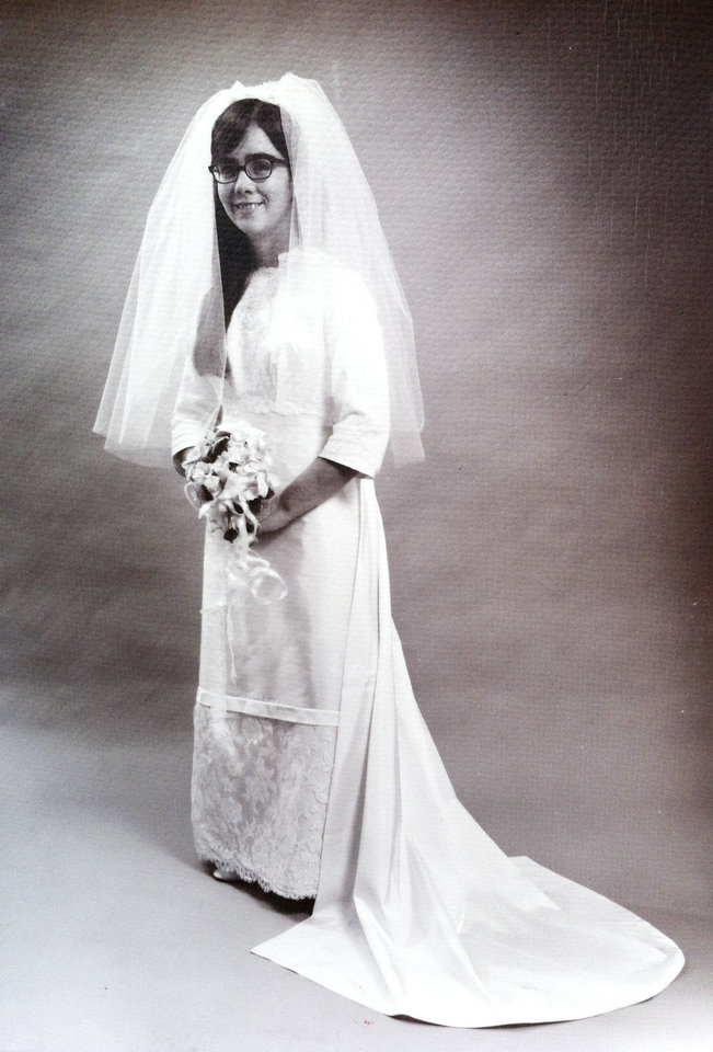 Photo - WEDDING DRESS: The 70s were a mix of hippy frocks and fairytale princesses, Yoko Ono and Farrah Fawcett are examples of each trend. In 1970, Sharon Seeley Strattis wore a gown with a combination of the stars gowns. Strattis is a simplistic and sophisticated dresser, said her daughter, Beth Canaday. Her wedding gown was just that, a simple combination of the tiers and straight to the floor style seen in Ono and Fawcett's dresses. Photo provided by Beth Canaday.