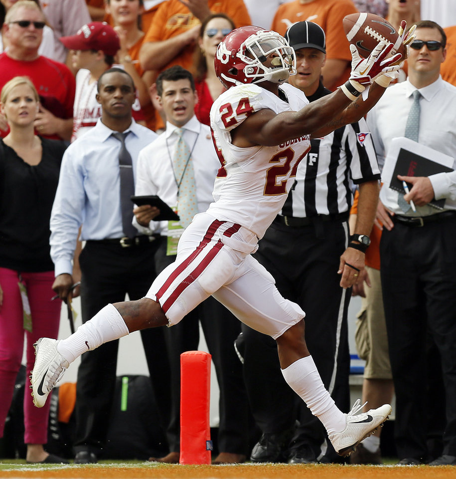 OU\'s Brennan Clay (24) drops a pass in the end zone in the first quarter during the Red River Rivalry college football game between the University of Oklahoma Sooners and the University of Texas Longhorns at the Cotton Bowl Stadium in Dallas, Saturday, Oct. 12, 2013. Photo by Nate Billings, The Oklahoman