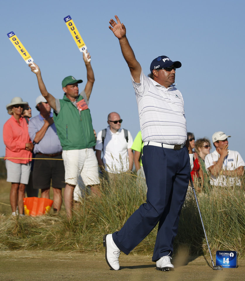 Photo - Angel Cabrera of Argentina gestures on the 14th tee box during the second round of the British Open Golf Championship at Muirfield, Scotland, Friday July 19, 2013. (AP Photo/Matt Dunham)
