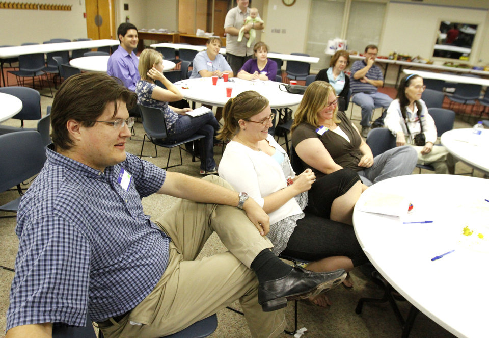 Photo - The first Tornado Town Hall meeting was Thursday at Norman Public Library. People in the weather-safety field asked residents what they've heard about and know about tornadoes. Photo by David McDaniel, The Oklahoman