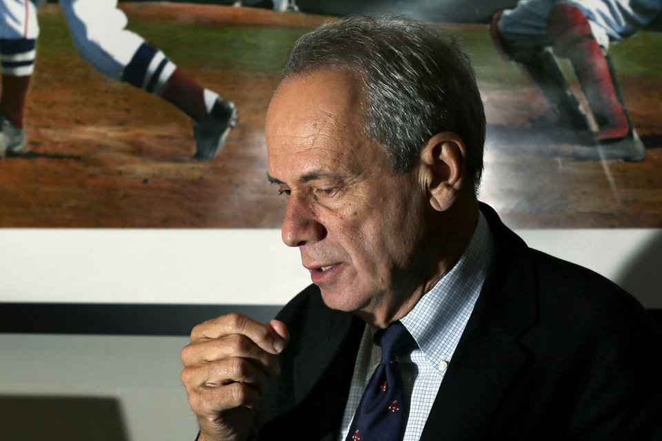 Photo -   Boston Red Sox President and CEO Larry Lucchino speaks during an interview at Fenway Park in Boston, Thursday, Oct. 4, 2012, hours after the team announced that manager Bobby Valentine will not return in 2013. The Red Sox finished their baseball season in last place for the first time in 20 years. (AP Photo/Elise Amendola)