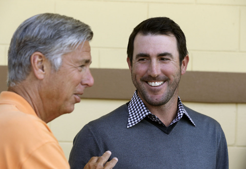 Photo - Detroit Tigers pitcher Justin Verlander, right, looks at team president, CEO and general manager Dave Dombrowski during a news conference after a spring baseball exhibition game on Friday, March 29, 2013, in Lakeland, Fla., where Verlander talked about his new seven-year, $180-million contract. (AP Photo/Carlos Osorio)