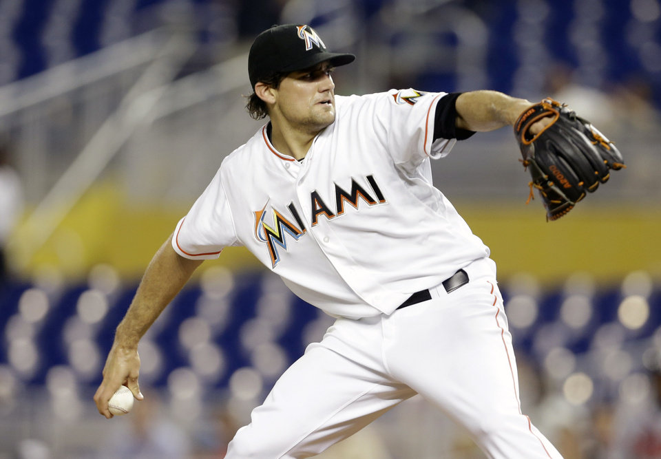 Photo - Miami Marlins starting pitcher Nate Eovaldi throws during the first inning of a baseball game against the Atlanta Braves, Wednesday, April 30, 2014, in Miami. (AP Photo)